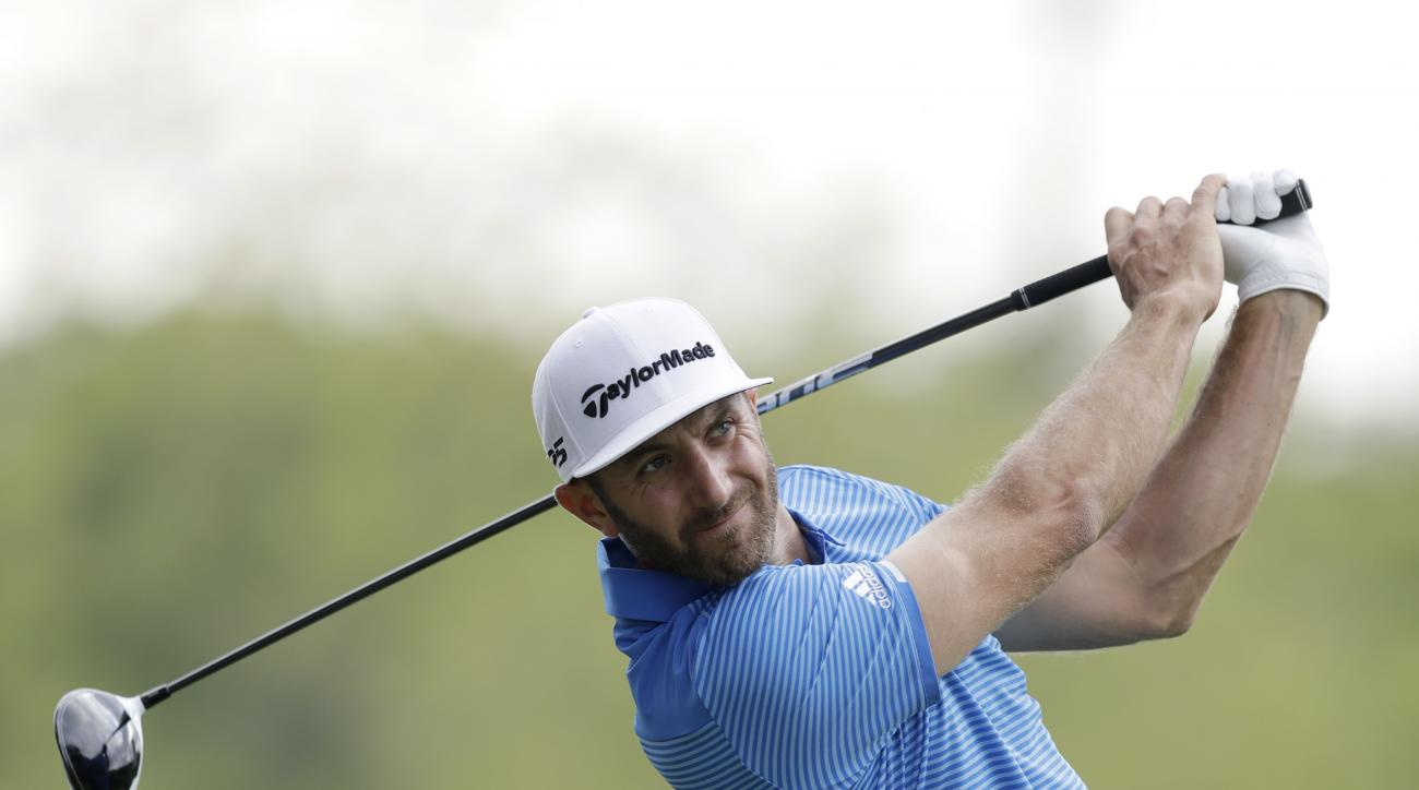 Dustin Johnson watches his tee shot on the second hole during semifinal play at the Dell Technologies Match Play golf tournament at Austin County Club, Sunday, March 26, 2017, in Austin, Texas. (AP Photo/Eric Gay)