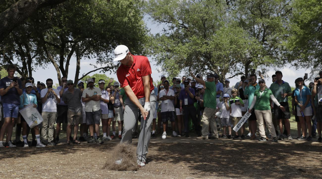 Jon Rahm, of Spain, hits from the rough on the sixth hole during the final round of play against Dustin Johnson at the Dell Technologies Match Play golf tournament at Austin County Club, Sunday, March 26, 2017, in Austin, Texas. (AP Photo/Eric Gay)