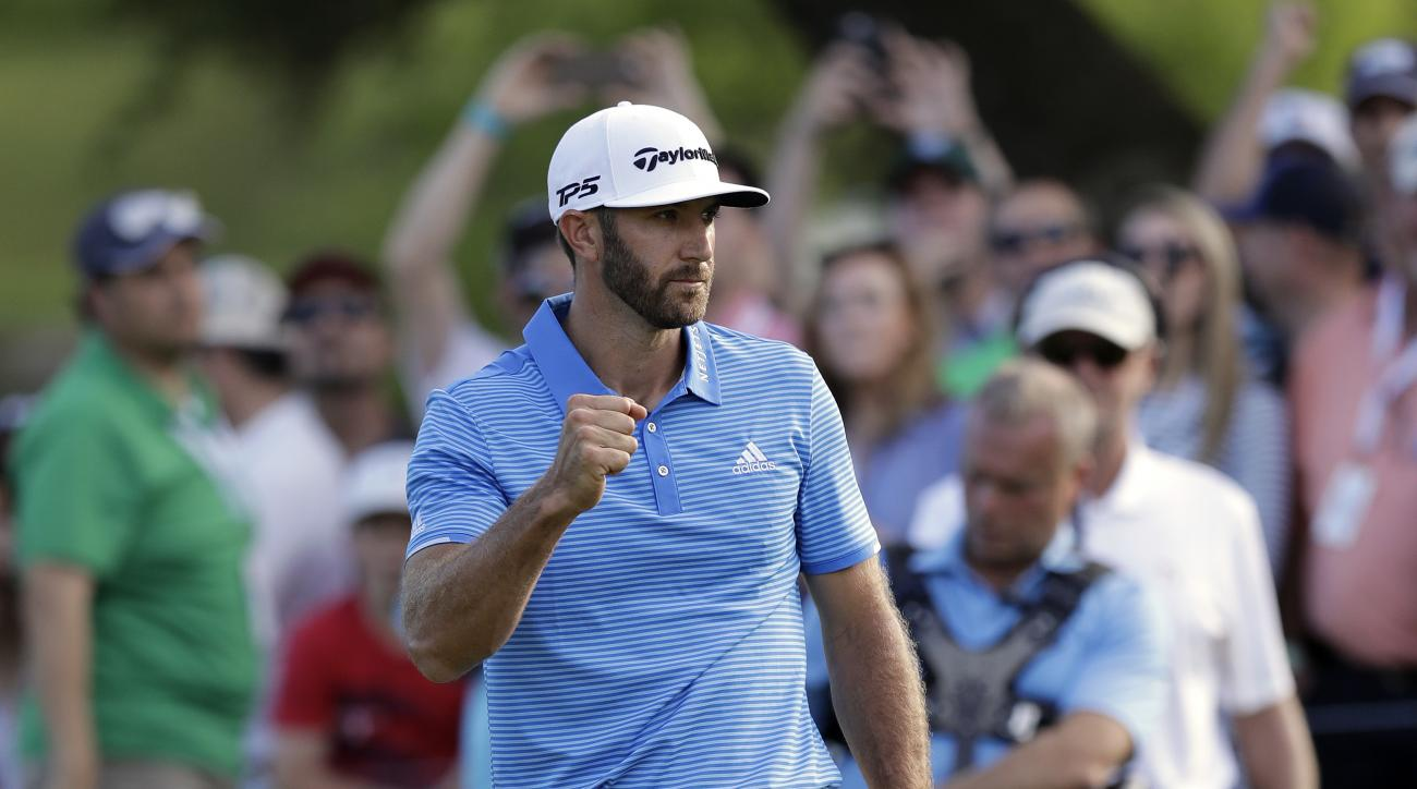 Dustin Johnson celebrates after sinking a putt to defeat Jon Rahm, of Spain, at the Dell Technologies Match Play golf tournament at Austin County Club, Sunday, March 26, 2017, in Austin, Texas. (AP Photo/Eric Gay)