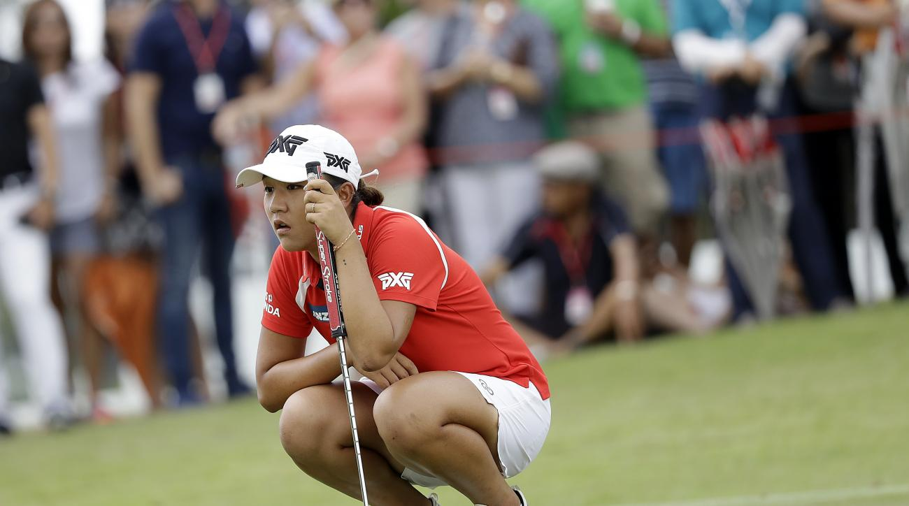 FILE - In this March 5, 2017, file photo, Lydia Kok, of New Zealand, checks her lines on the 11th hole during the HSBC Women's Champions golf tournament held at Sentosa Golf Club's Tanjong course in Singapore. The world's No. 1-ranked player hopes to get