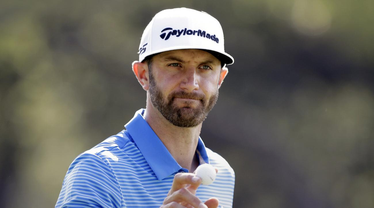 FILE - In this March 26, 2017, file photo, Dustin Johnson waves to the gallery after a birdie putt on the sixth hole during semifinal play at the Dell Technologies Match Play golf tournament at Austin County Club in Austin, Texas. (AP Photo/Eric Gay, File
