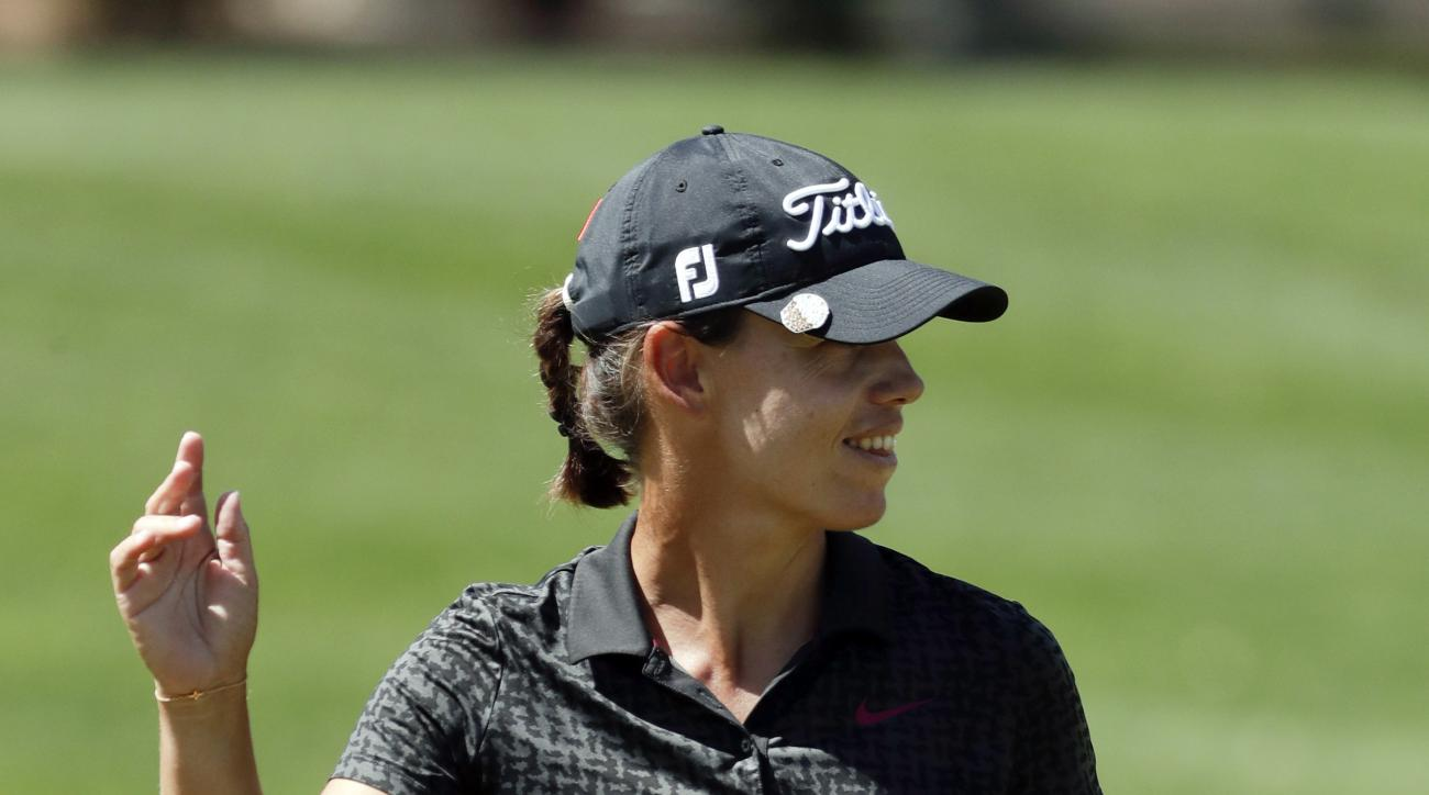 Karine Icher of France, waves after a birdie on the 17th hole during the first round of the LPGA Tour ANA Inspiration golf tournament at Mission Hills Country Club Thursday, March 30, 2017 in Rancho Mirage, Calif. (AP Photo/Chris Carlson)
