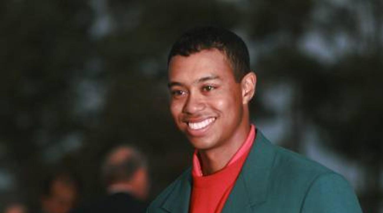 FILE - In this April 13, 1997 file photo, Masters champion Tiger Woods holding a replica of the Masters Trophy after winning the golf tournament at the Augusta National Golf Club in Augusta, Ga. It has been 20 years since Woods won the Masters for the fir