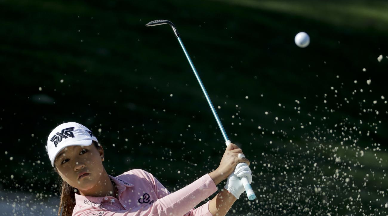 Lydia Ko hits out of the bunker on the 17th hole during the wind-delayed first round of the LPGA Tour ANA Inspiration golf tournament at Mission Hills Country Club Friday, March 31, 2017 in Rancho Mirage, Calif. (AP Photo/Chris Carlson)