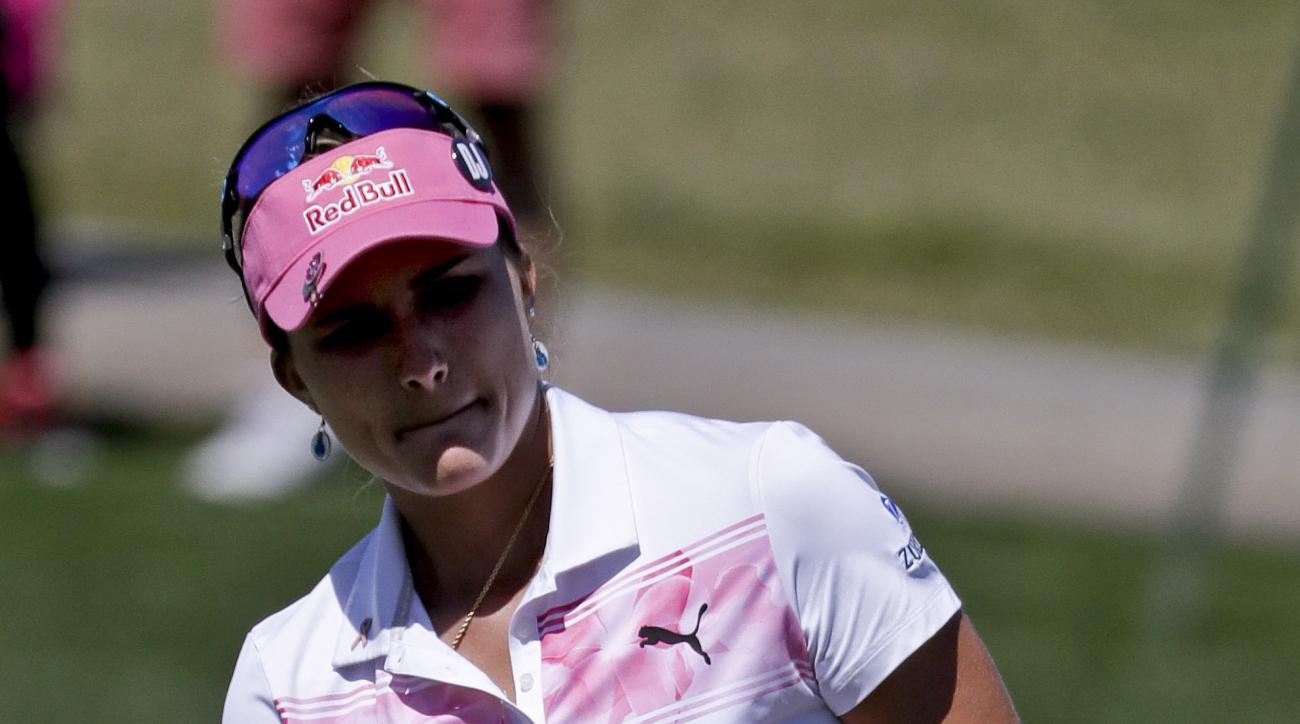 Lexi Thompson watches her putt on the second hole during the third round of the LPGA Tour's ANA Inspiration golf tournament at Mission Hills Country Club on Saturday, April 1, 2017, in Rancho Mirage, Calif. (AP Photo/Chris Carlson)