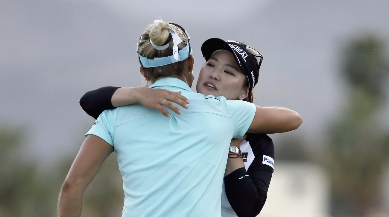 Lexi Thompson, left, congratulates So Yeon Ryu, of South Korea, after Ryu made a birdie putt on the playoff hole to win the LPGA Tour's ANA Inspiration golf tournament at Mission Hills Country Club in Rancho Mirage, Calif., Sunday, April 2, 2017. (AP Phot
