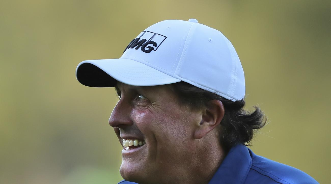 Phil Mickelson smiles after chipping it in for an eagle on the third hole during a practice round at the Masters golf tournament, Tuesday, April 4, 2017, in Augusta, Ga. (Curtis Compton/Atlanta Journal-Constitution via AP)