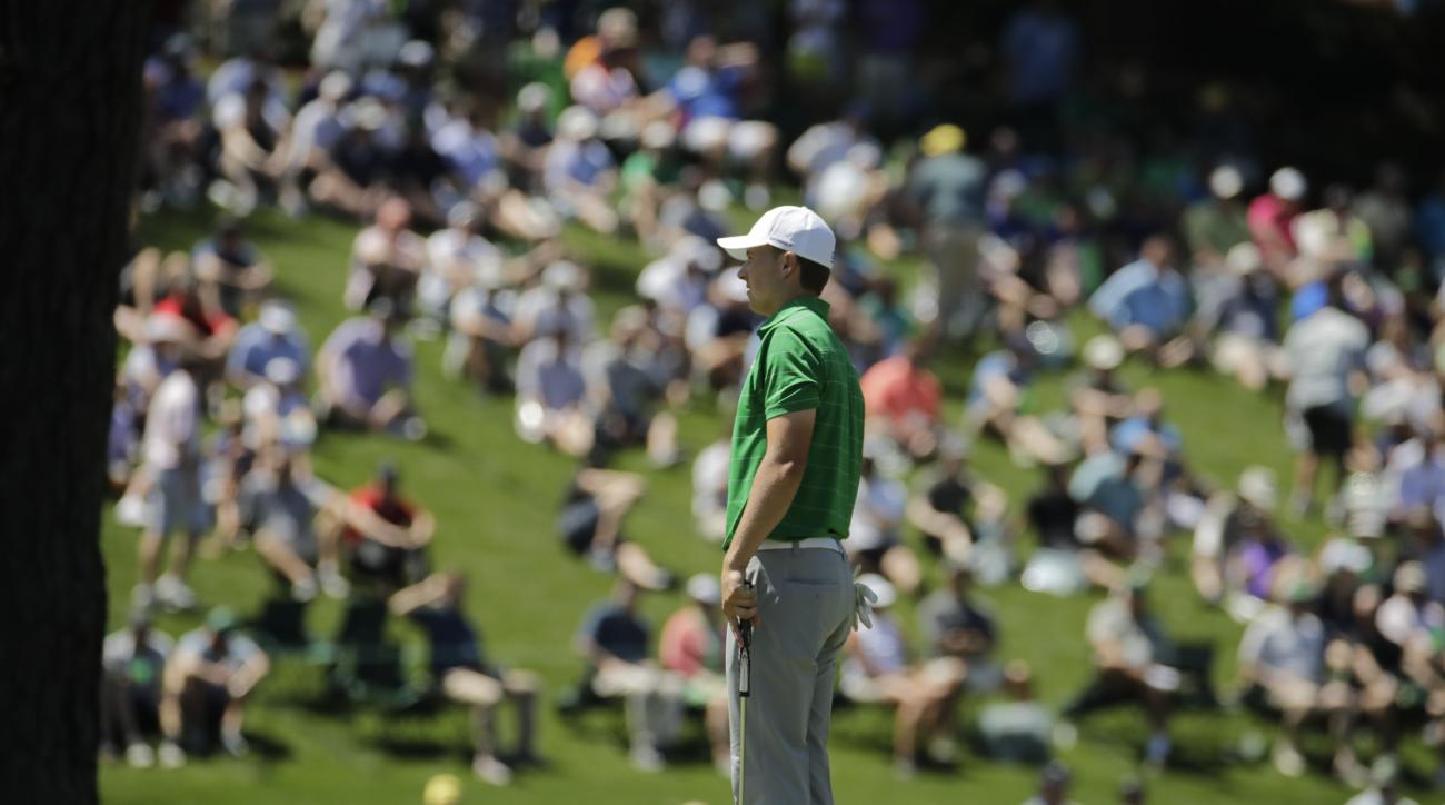 Jordan Spieth lines up his putt on the 15th hole during a practice round for the Masters golf tournament Tuesday, April 4, 2017, in Augusta, Ga. (AP Photo/Charlie Riedel)