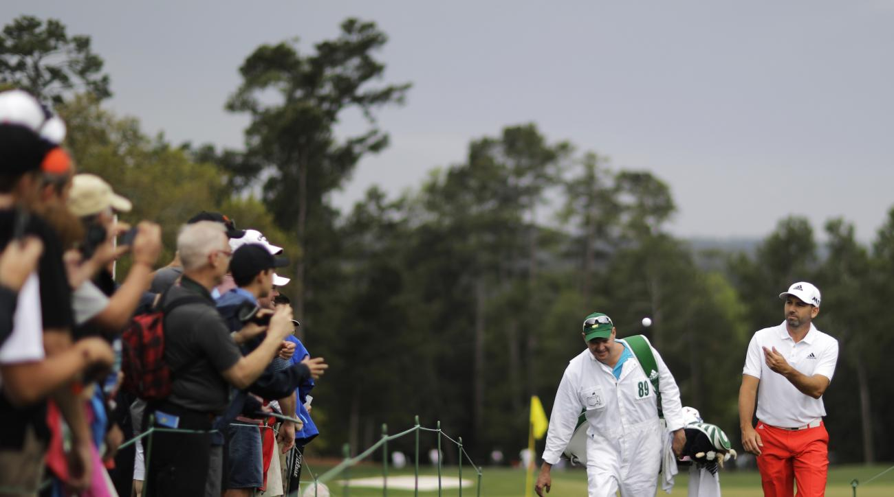Sergio Garcia, of Spain, tosses a ball to a fan on the ninth hole during a practice round for the Masters golf tournament Wednesday, April 5, 2017, in Augusta, Ga. (AP Photo/David Goldman)