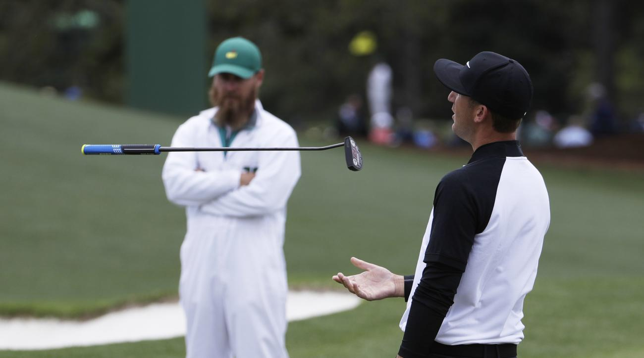 Kevin Chappell flips his putt as he putts on the 18th during the first round for the Masters golf tournament Thursday, April 6, 2017, in Augusta, Ga. (AP Photo/David Goldman)