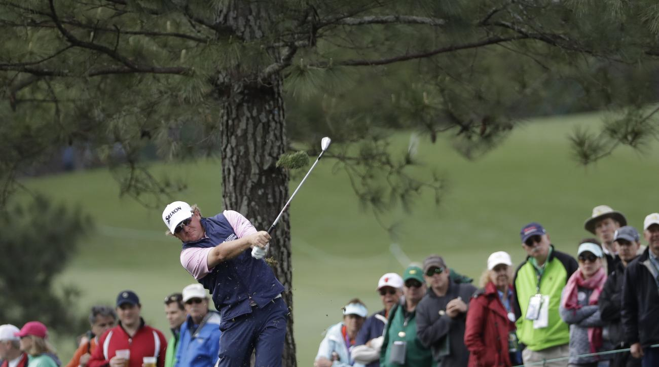 Will McGirt hits to the 18th green during the first round for the Masters golf tournament Thursday, April 6, 2017, in Augusta, Ga. (AP Photo/David J. Phillip)