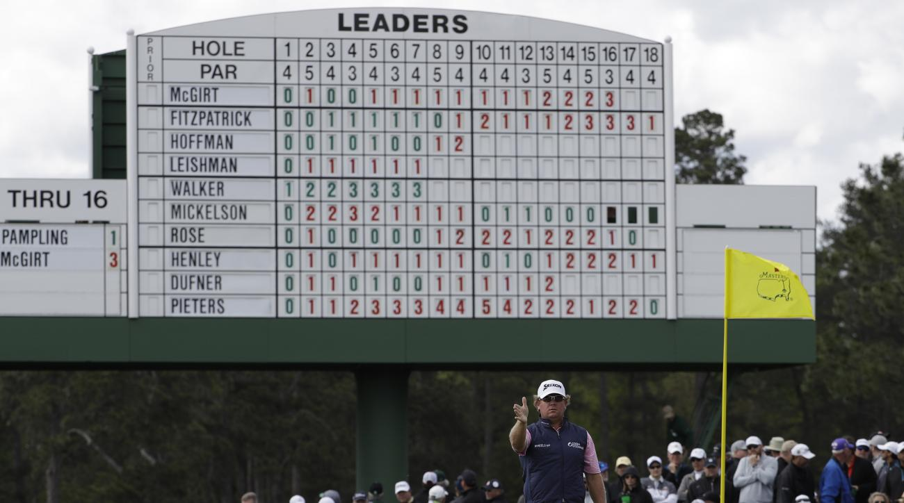 Will McGirt looks over a putt on the 18th hole during the first round for the Masters golf tournament Thursday, April 6, 2017, in Augusta, Ga. (AP Photo/David J. Phillip)