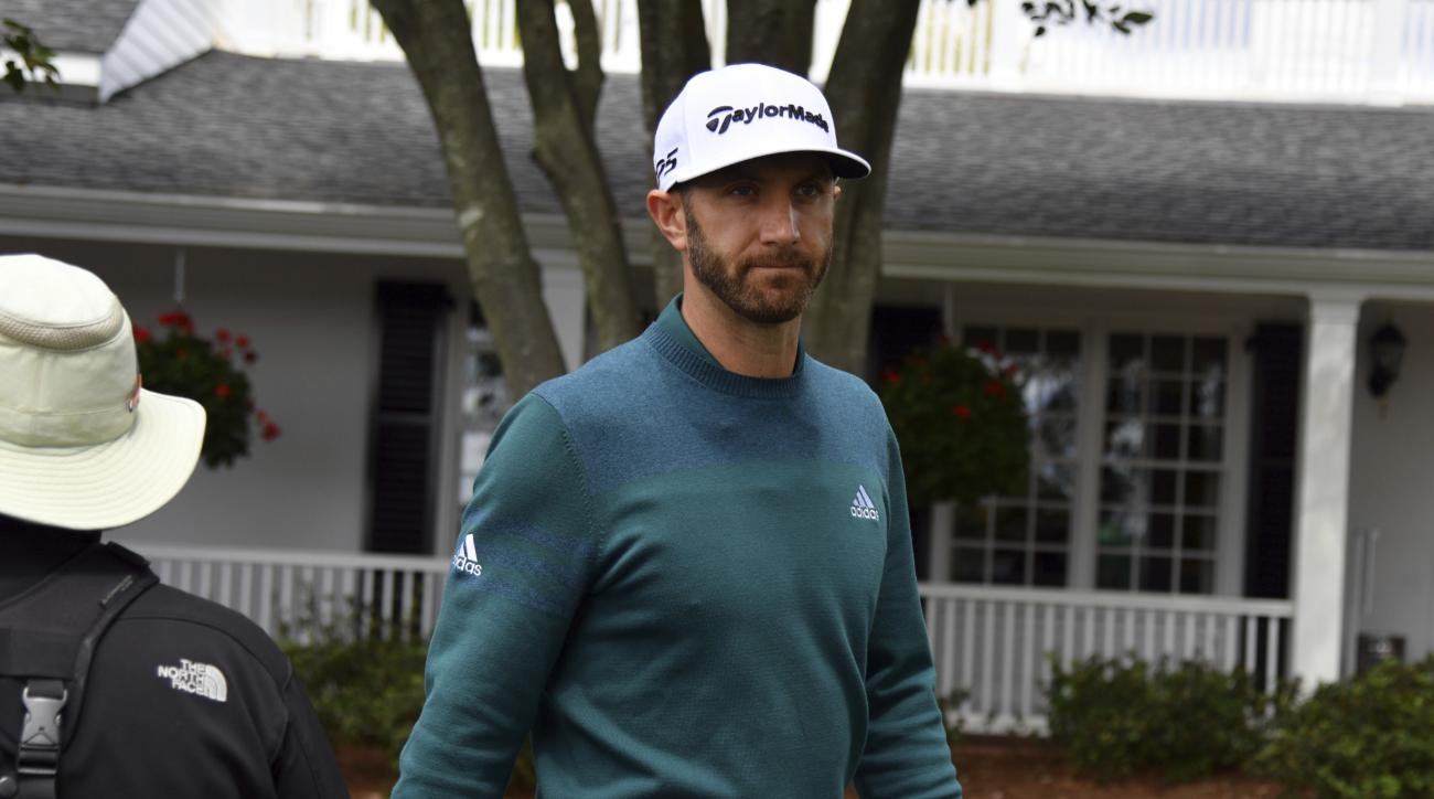 Dustin Johnson walks off the 1st tee after deciding not to play in the opening round of the Masters golf tournament at the Augusta National Golf Club in Augusta, Ga., Thursday, April 6, 2017. The world's No. 1-ranked player was, however, forced to withdra