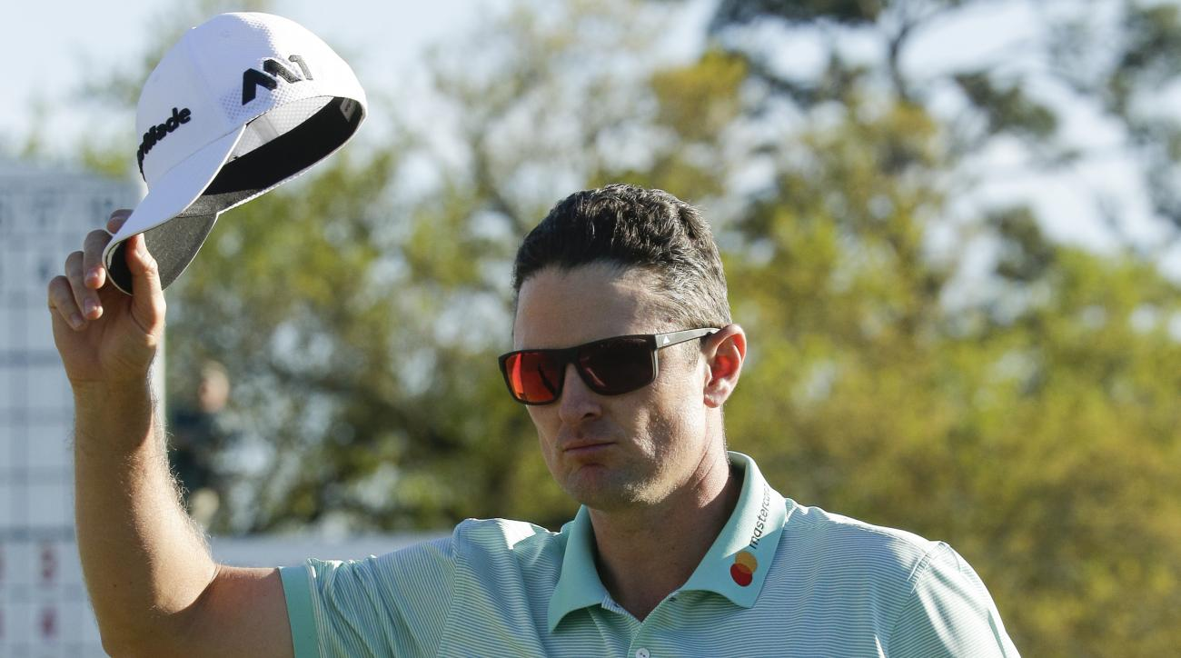 Justin Rose, of England, tips his hat on the 18th hole during the third round of the Masters golf tournament Saturday, April 8, 2017, in Augusta, Ga. (AP Photo/Charlie Riedel)