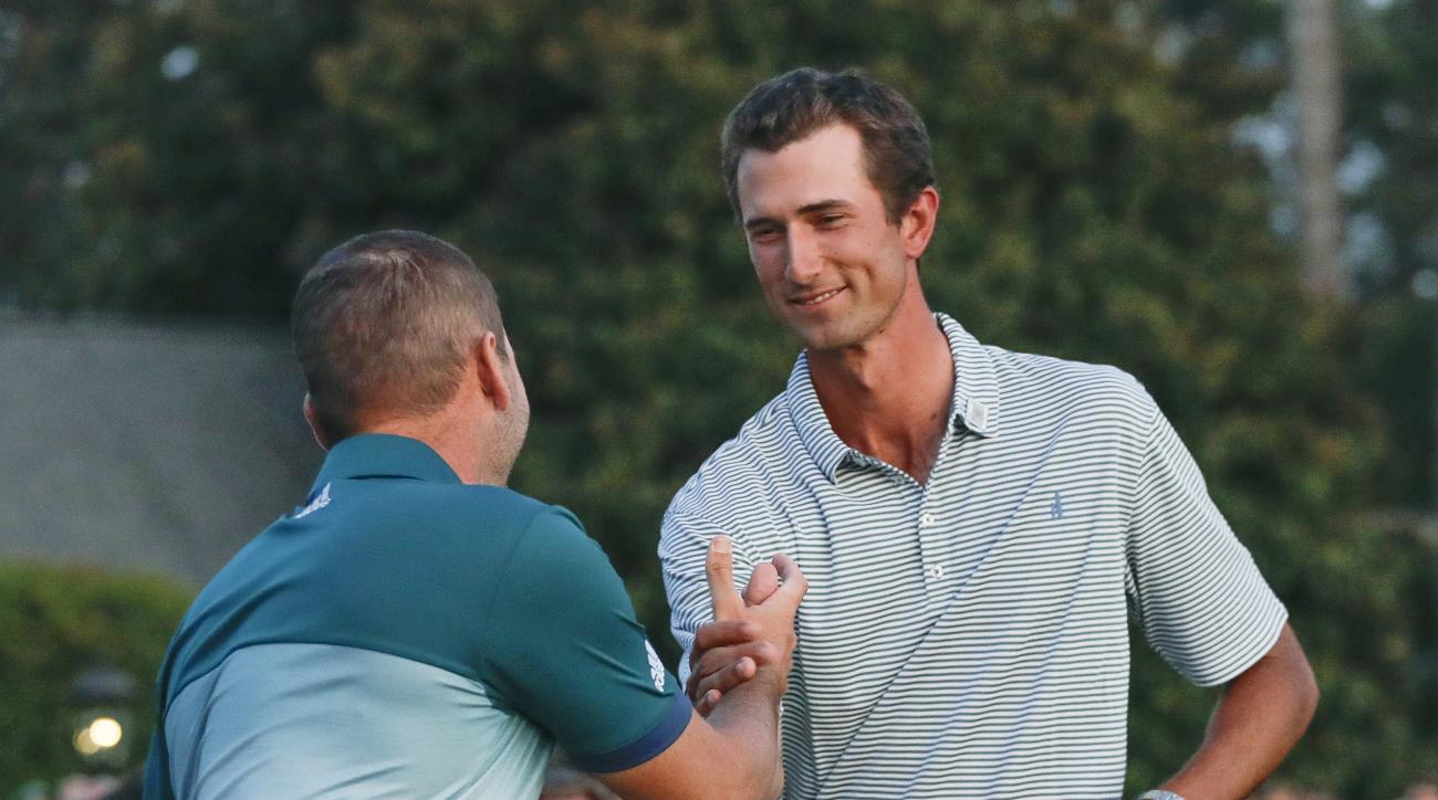 Sergio Garcia, of Spain, lefts, shakes hands with low amateur Stewart Hagestad after the Masters golf tournament, Sunday, April 9, 2017, in Augusta, Ga. (AP Photo/Chris Carlson)