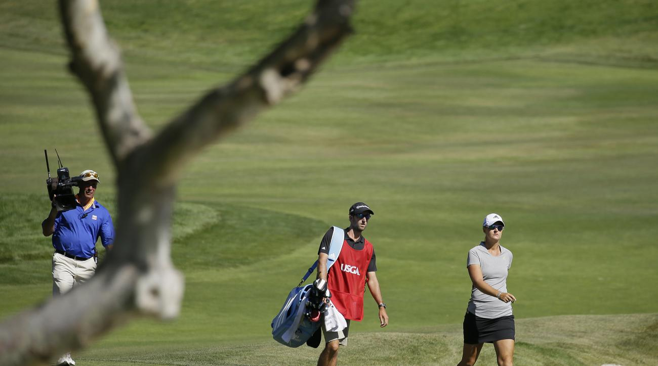 FILE - In this July 10, 2016, file photo, Anna Nordqvist, of Sweden, walks to the green after hitting out of a bunker on the second playoff hole of the U.S. Women's Open golf tournament at CordeValle, in San Martin, Calif.  Nordqvist was penalized for cli