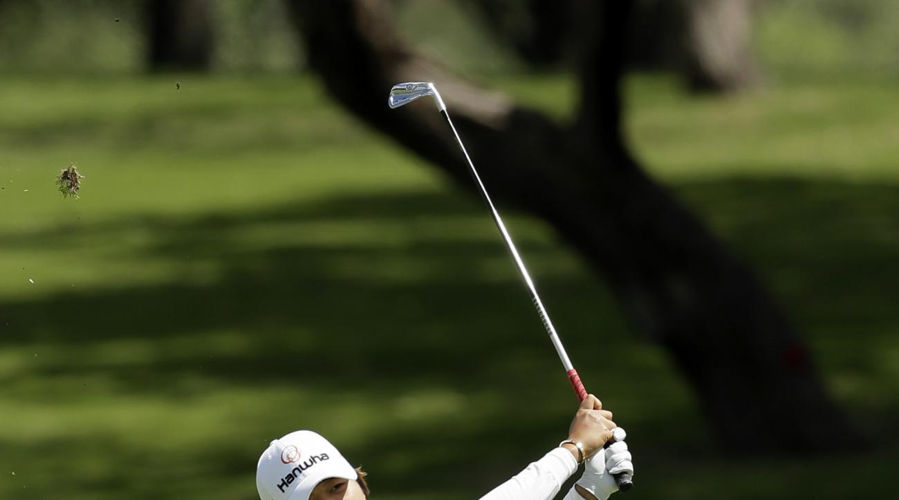 Haru Nomura, of Japan, hits an approach shot shot on the ninth hole during the final round of the LPGA Texas Shootout golf tournament in Irving, Texas, Sunday, April 30, 2017. (AP Photo/LM Otero)