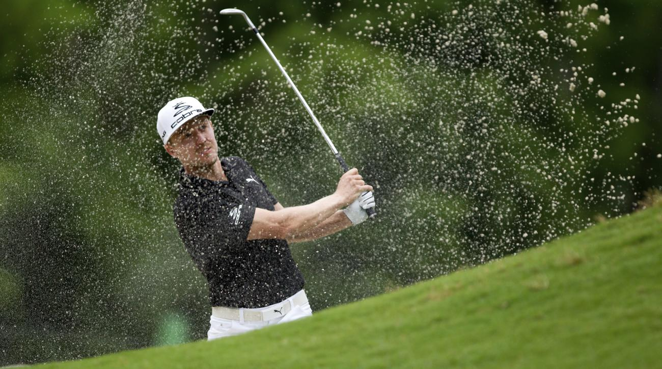 Jonas Blixt, of Sweden, hits out of sand trap on the second hole during the final round of the PGA Zurich Classic golf tournament's new two-man team format at TPC Louisiana in Avondale, La., Sunday, April 30, 2017. (AP Photo/Scott Threlkeld)