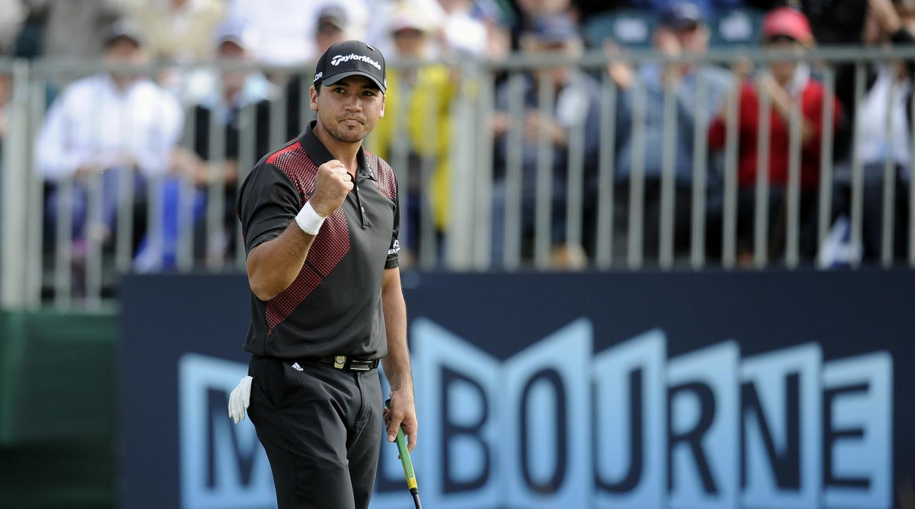 Jason Day of Australia celebrates on the 18th green after winning the World Cup of Golf  tournament at Royal Melbourne Golf Course in Australia, Sunday, Nov. 24, 2013. (AP Photo/Andy Brownbill)