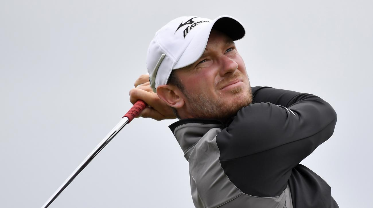 FILE - A Saturday, Nov. 26, 2016 file photo showing England's Chris Wood watching his tee shot on the sixth hole during his match at the World Cup of Golf at Kingston Heath in Melbourne, Australia. Golf gets another makeover this weekend when the European