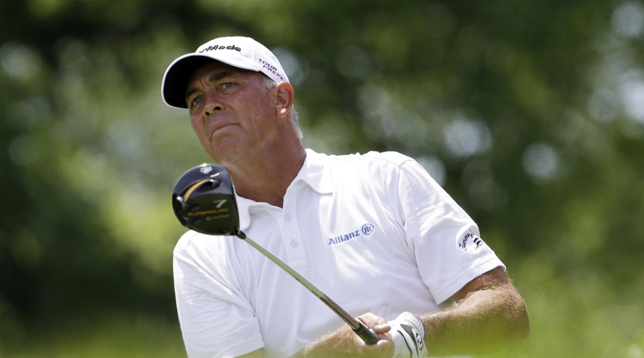 FILE - In a Sunday, June 22, 2014 file photo, Tom Lehman watches his tee shot on the third hole during the final round of the Encompass Championship golf tournament in Glenview, Ill. One of the vice captains for the U.S. team, Lehman's role in support of