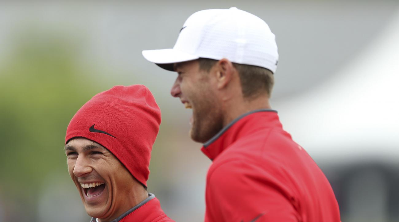 Denmark's Lucas Bjerregaard, left and Thorbjorn Olesen, react, during day one of the Golf Sixes at the Centurion Club, in St Albans, England, Saturday May 6, 2017. The European Tour rolls out its latest innovative tournament, the six-hole GolfSixes event