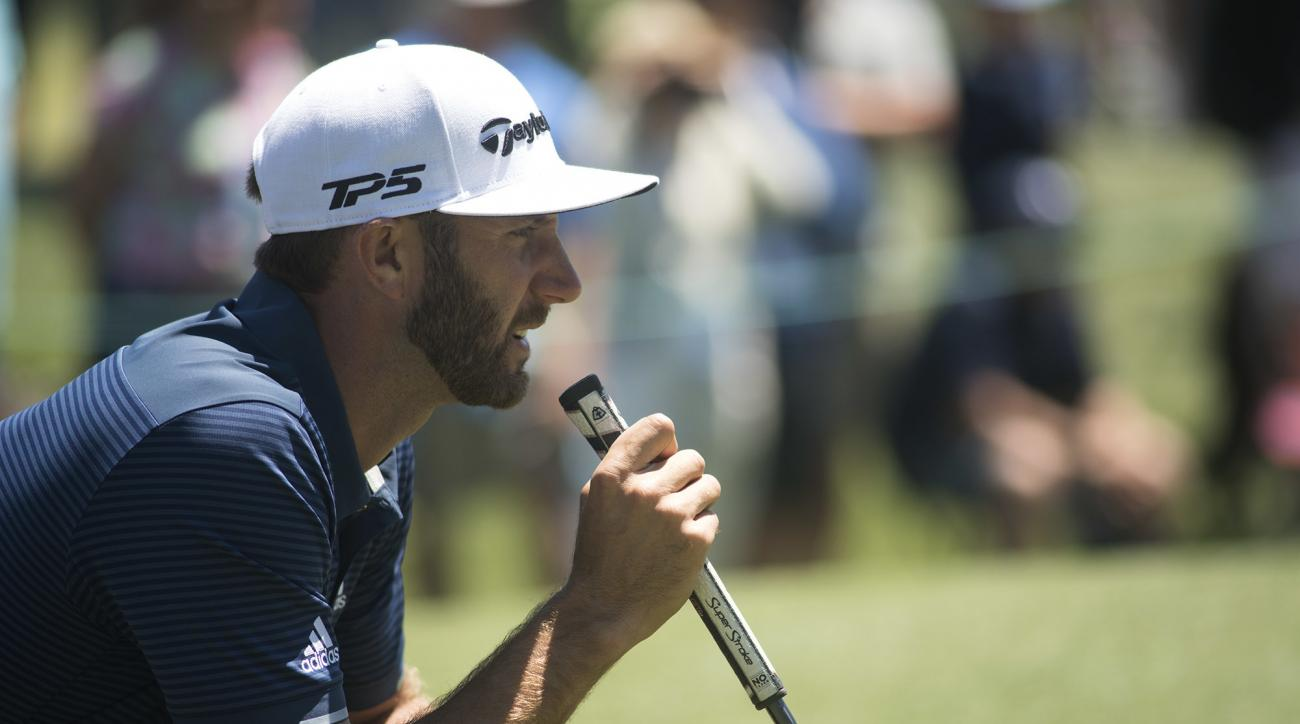 Dustin Johnson line up his shot on the first hole during the final round of the Wells Fargo Championship golf tournament at Eagle Point Golf Club in Wilmington, N.C., Sunday, May 7, 2017. (AP Photo/Mike Spencer)