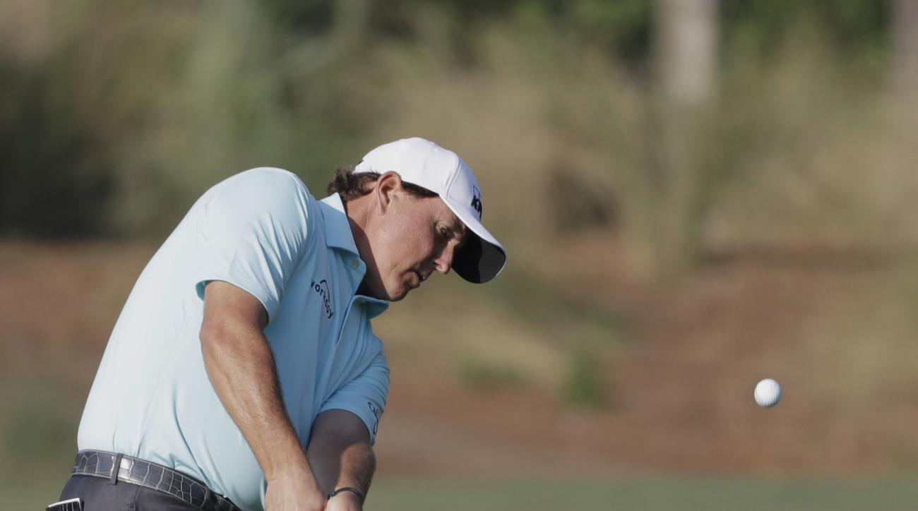 Phil Mickelson hits on the 10th green during the first round of The Players Championship golf tournament Thursday, May 11, 2017, in Ponte Vedra Beach, Fla. (AP Photo/Chris O'Meara)