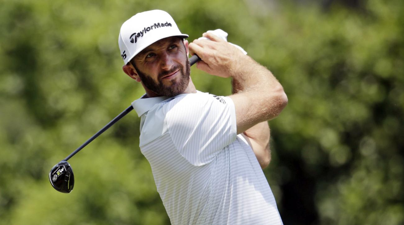 Dustin Johnson hits from the second tee during the first round of The Players Championship golf tournament Thursday, May 11, 2017, in Ponte Vedra Beach, Fla. (AP Photo/Lynne Sladky)