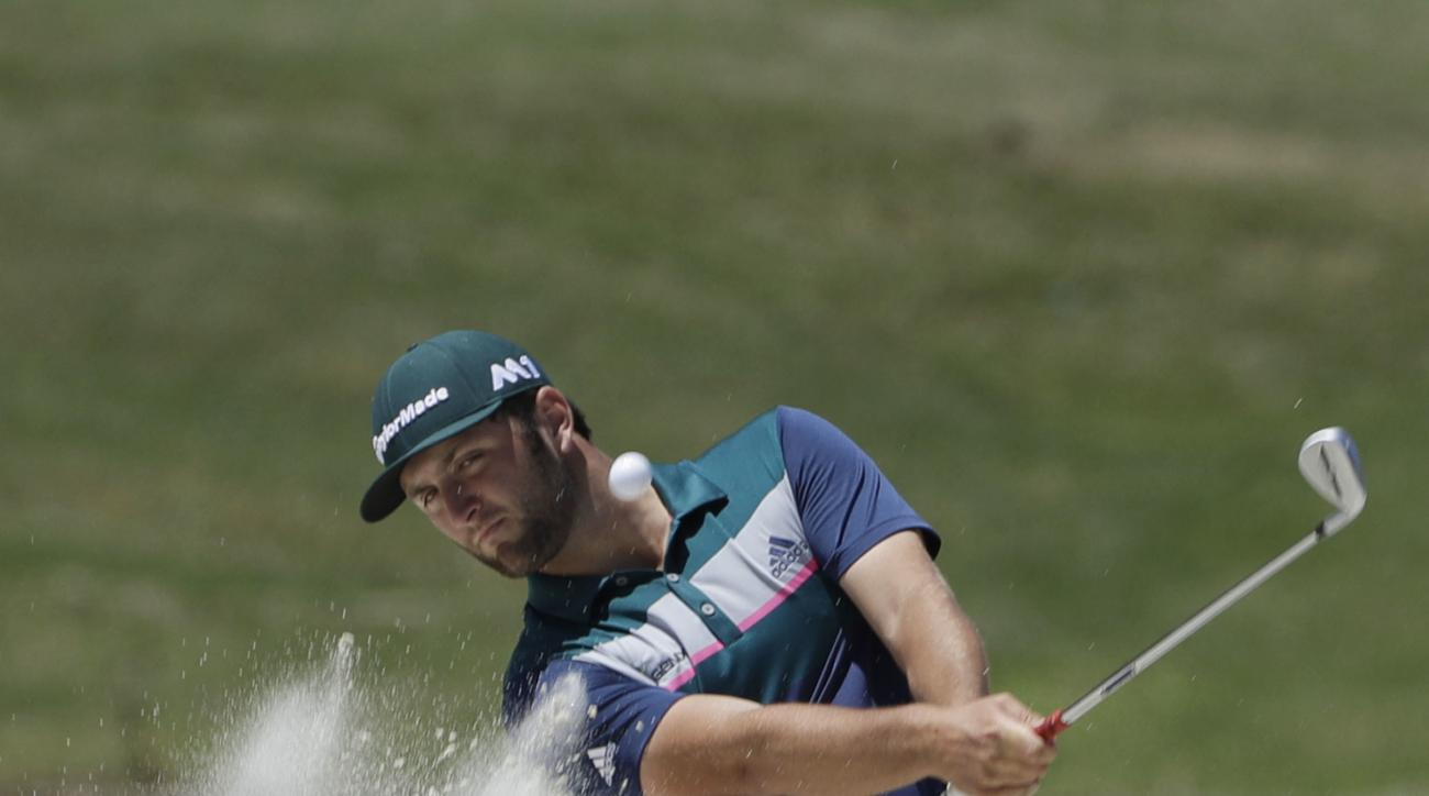Jon Rahm, of Spain, hits from the sand on the seventh hole during the second round of The Players Championship golf tournament Friday, May 12, 2017, in Ponte Vedra Beach, Fla. (AP Photo/Chris O'Meara)