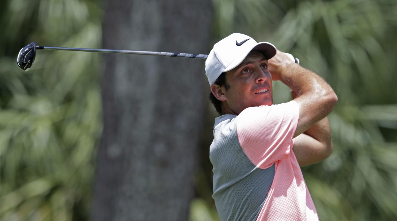 Francesco Molinari of Italy, follows his shot from the second tee, during the final round of The Players Championship golf tournament Sunday, May 14, 2017, in Ponte Vedra Beach, Fla. (AP Photo/Lynne Sladky)