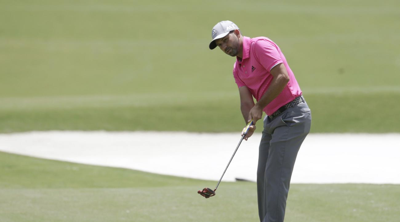 Sergio Garcia, of Spain, putts on the first green during the final round of The Players Championship golf tournament Sunday, May 14, 2017, in Ponte Vedra Beach, Fla. (AP Photo/Lynne Sladky)