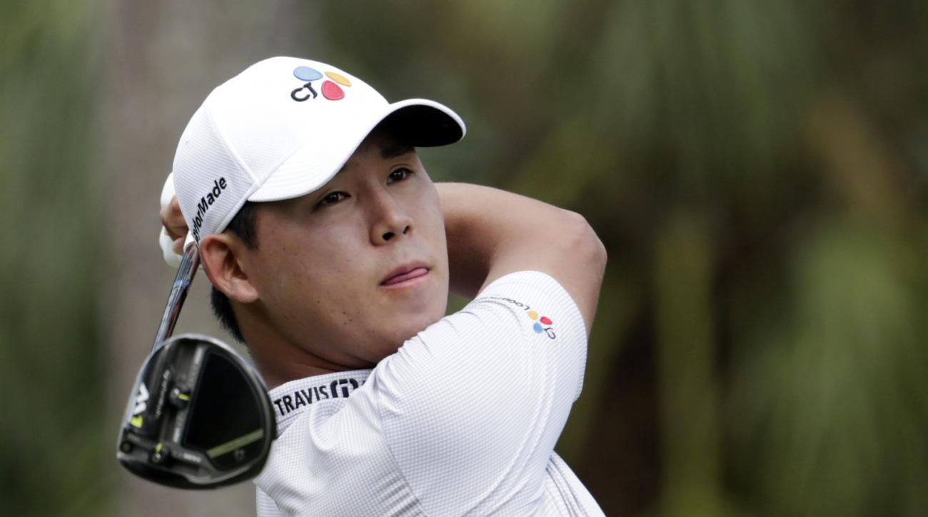 Si Woo Kim, of South Korea, watches his shot from the second tee during the final round of The Players Championship golf tournament Sunday, May 14, 2017, in Ponte Vedra Beach, Fla. (AP Photo/Lynne Sladky)