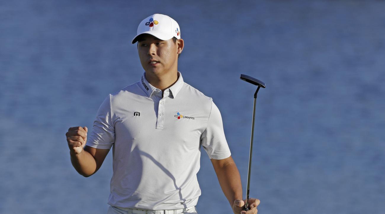 Si Woo Kim of South Korea, celebrates winning The Players Championship golf tournament Sunday, May 14, 2017, in Ponte Vedra Beach, Fla. (AP Photo/Chris O'Meara)