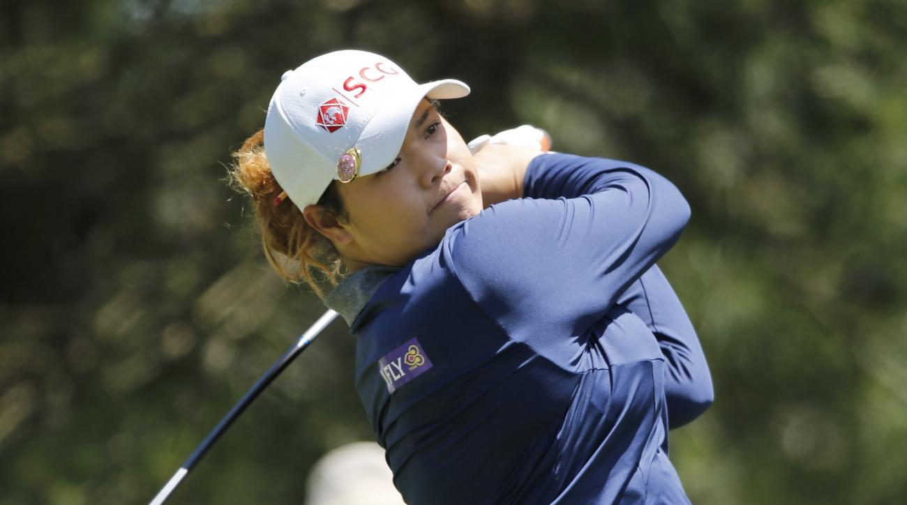 Defending champion Aria Jutanugarn watches her tee shot on the ninth hole during the first round of the Kingsmill Championship LPGA golf tournament in Williamsburg, Va., Thursday, May 18, 2017. (AP Photo/Steve Helber)