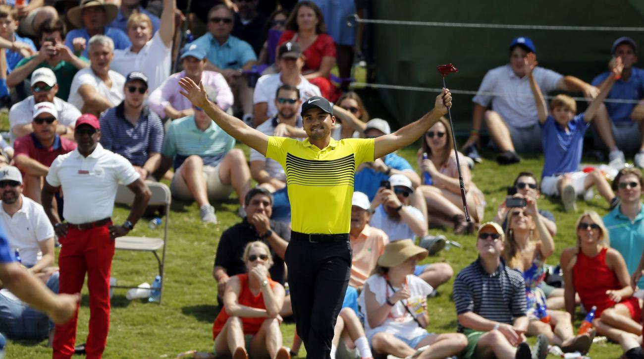 Jason Day, of Australia, celebrates with fans after Day sunk a 60-foot putt on the 17th green during the third round of the Byron Nelson golf tournament, Saturday, May 20, 2017, in Irving, Texas. (AP Photo/Tony Gutierrez)