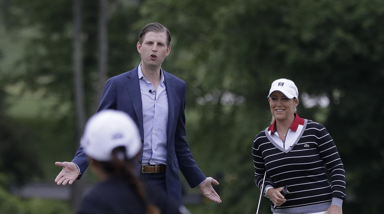 Eric Trump, top left, talks to professional golfers Cristie Kerr, top right, and Lydia Ko prior to the start of a news conference previewing the U.S. Women's Open Championship at Trump National Golf Club, Wednesday, May 24, 2017, in Bedminster, N.J. (AP P