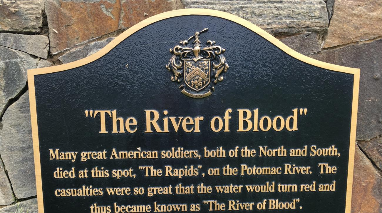 A plaque, displayed on a monument between the 15th and 16th holes at Trump National Golf Club in Sterling, Va., commemorates a Civil War battle that, according to some historians, never happened. The Senior PGA Championship is being played at Trump Nation