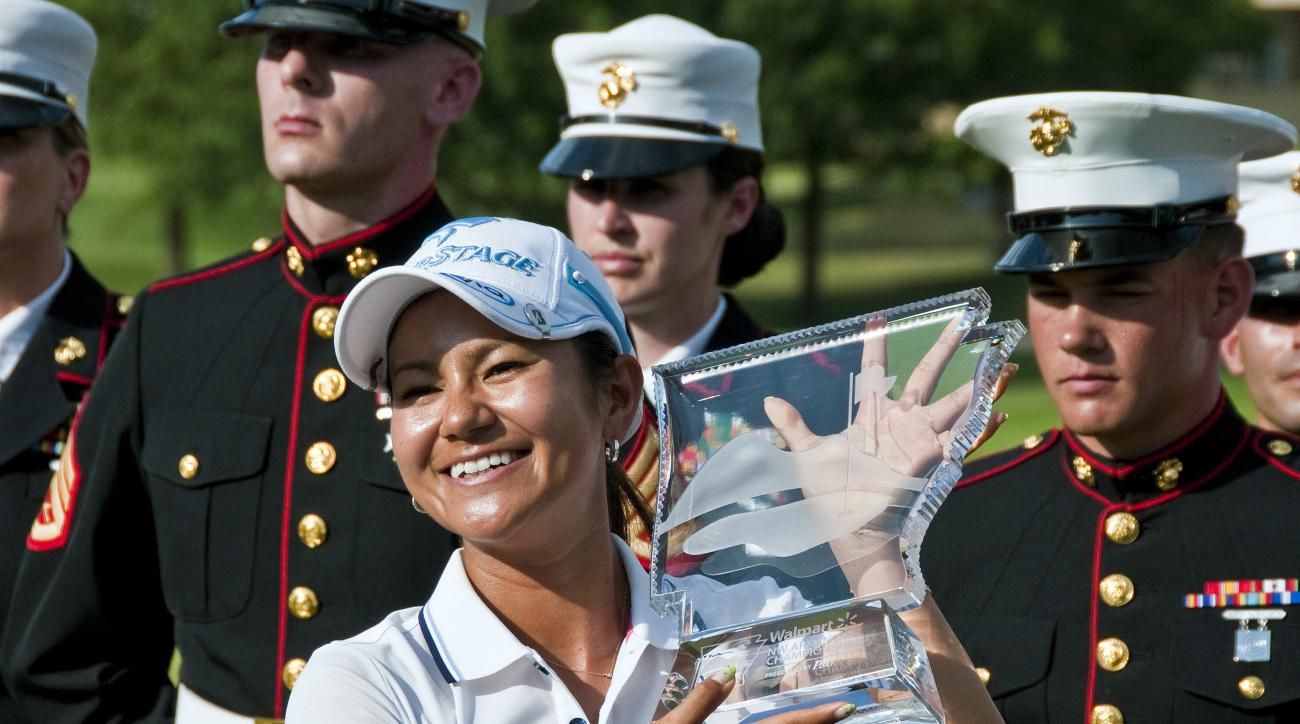 FILE - In this Sunday, July 1, 2012, file photo, Ai Miyazato poses with the championship trophy as members of the U.S. Marine Corps stand at attention behind her during a ceremony after Miyazato won the LPGA NW Arkansas Championship golf tournament in Rog