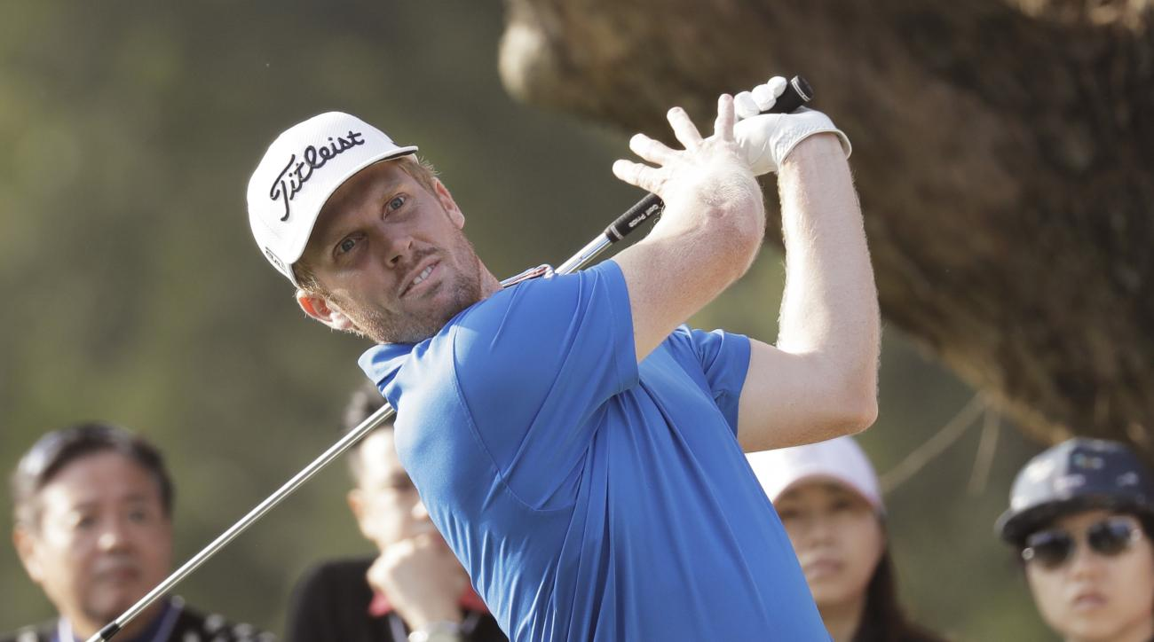 Andrew Dodt of Australia tees off on the 18th hole at the Hong Kong Open golf tournament in Hong Kong, Sunday, Dec. 11, 2016. Australia's Sam Brazel birdied the 18th hole to narrowly edge Rafa Cabrera Bello to capture the Hong Kong Open on Sunday, his fir