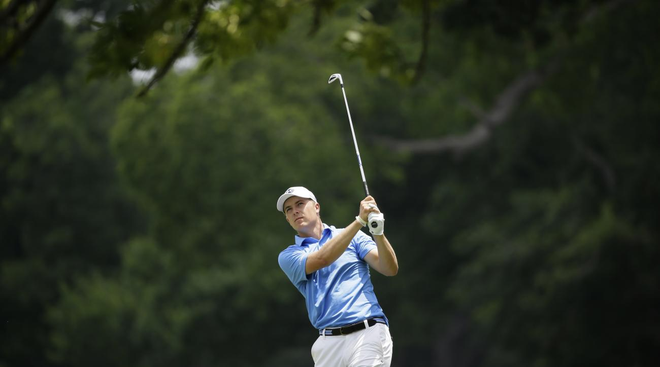 Jordan Spieth watches his approach shot on the 5th green during the third round of the Dean & DeLuca Invitational golf tournament at Colonial Country Club in Fort Worth, Texas, Saturday, May 27, 2017. (AP Photo/LM Otero)