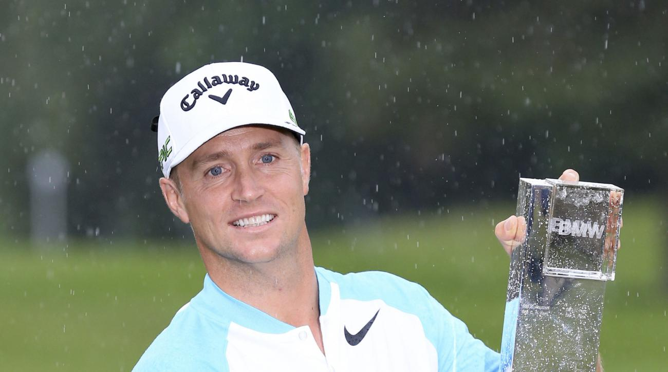 Sweden's Alex Noren kisses the trophy after winning the 2017 BMW PGA Championship at Wentworth Golf Club, Virginia Water, England, Sunday May 28, 2017. (Nigel French/PA via AP)