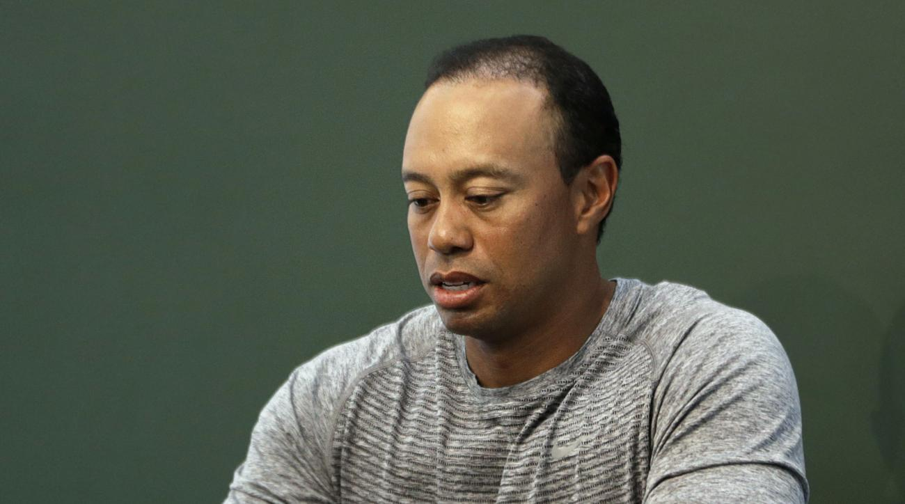 FILE - In this March 20, 2017, file photo, golfer Tiger Woods prepares to sign copies of his new book at a book signing in New York. Police say golf great Tiger Woods has been arrested on a DUI charge in Florida. The Palm Beach County Sheriff's Office say