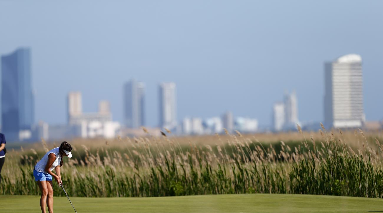 With the Atlantic City skyline as a back drop Gerina Piller putts on the second green during the second round of the ShopRite LPGA Classic golf tournament, Saturday, May 30, 2015, in Galloway Township, N.J. (AP Photo/Rich Schultz)