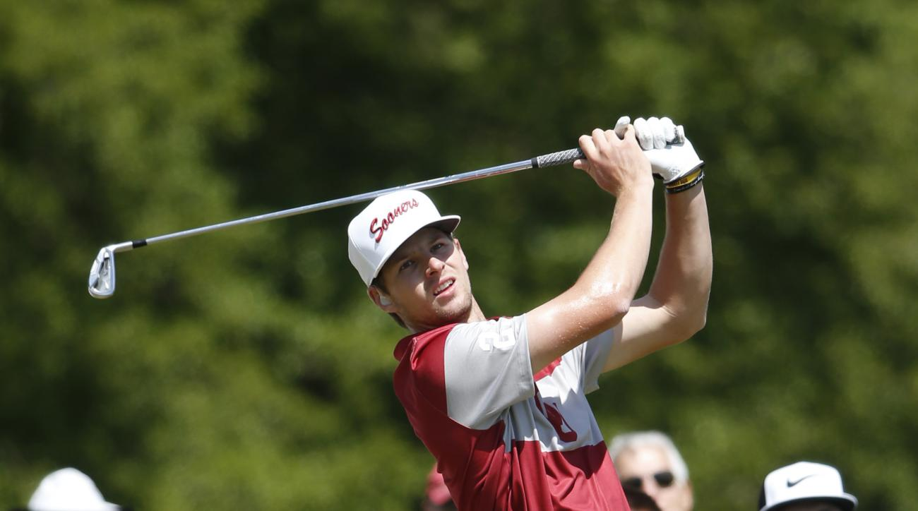 Oklahoma's Rylee Reinertson watches his tee shot on the final round of the NCAA Division I Men's Golf Championships against Oregon at Rich Harvest Farms Wednesday, May 31, 2017, in Sugar Grove, Ill. (AP Photo/Charles Rex Arbogast)
