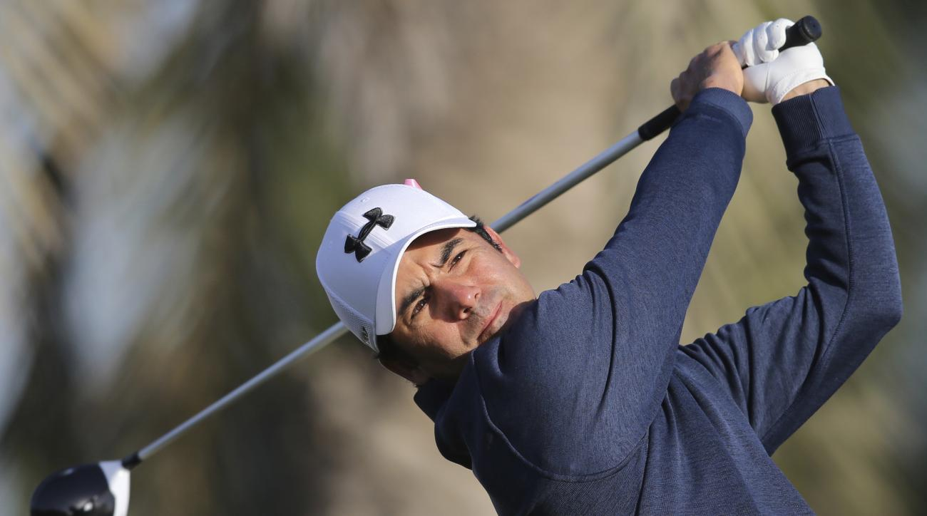 Felipe Aguilar of Chili tees off on the 2nd hole during the 2nd round completion of the Dubai Desert Classic golf tournament in Dubai, United Arab Emirates, Saturday, Feb. 4, 2017. (AP Photo/Kamran Jebreili)