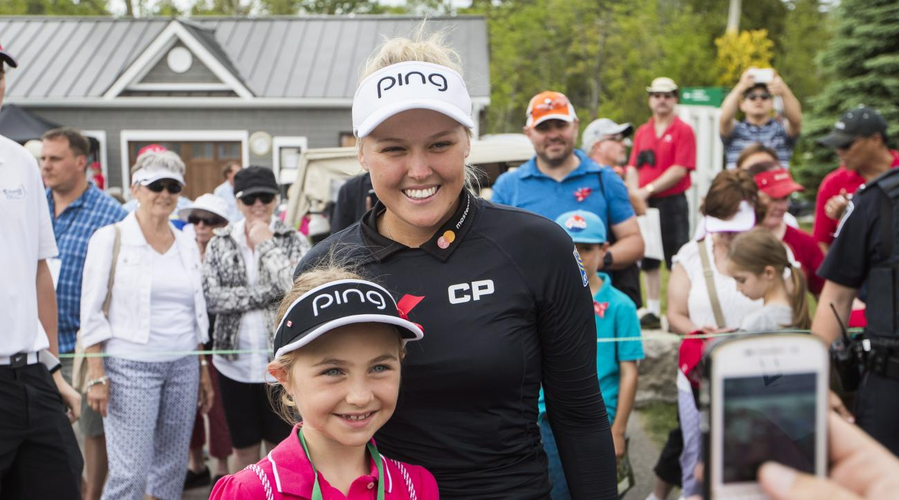 Brooke Henderson of Canada interacts with fans follwing her second round of the LPGA Classic at Whistle Bear Golf Club in Cambridge, Ont., on Friday, June 9, 2017. (Mark Blinch/The Canadian Press via AP)