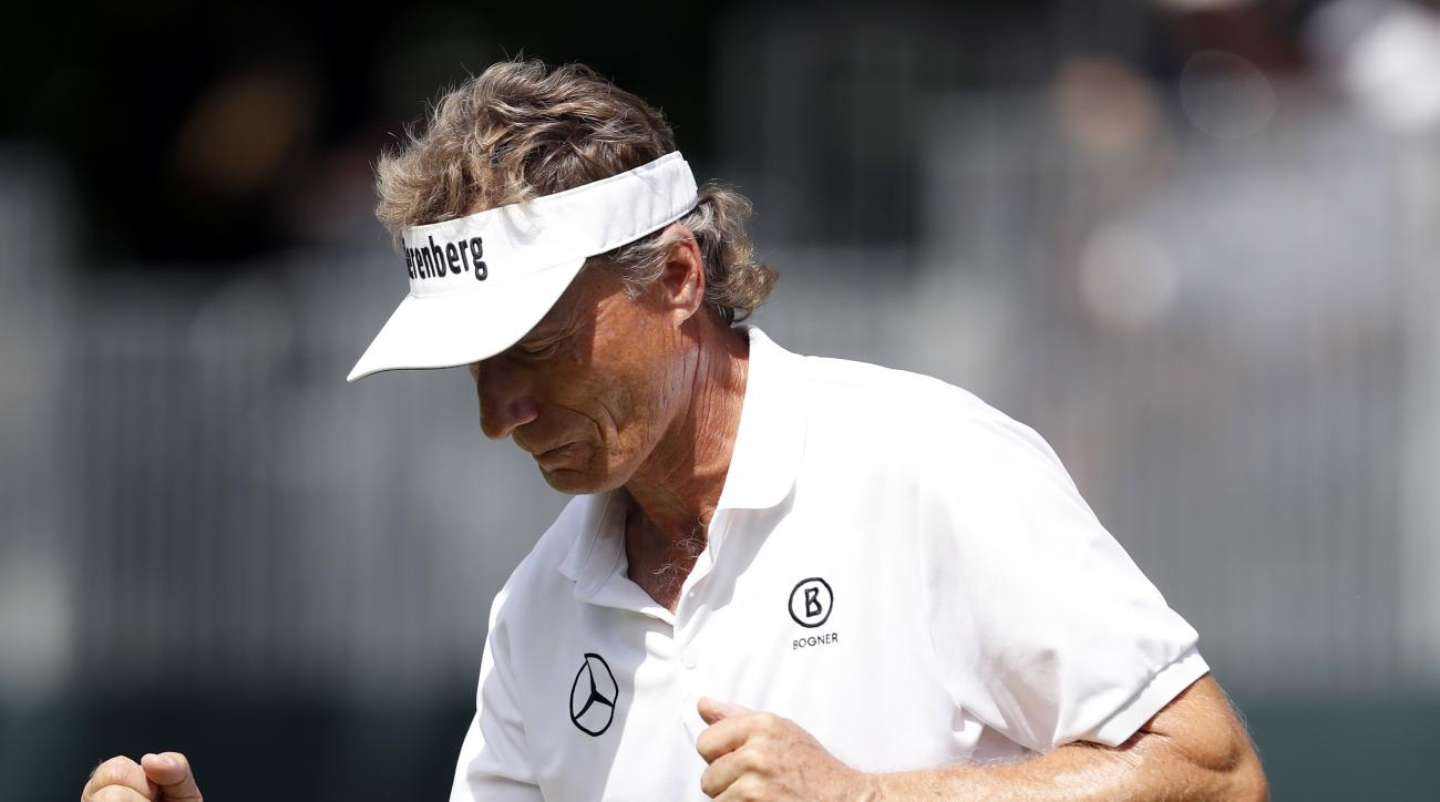 Bernhard Langer reacts after making a birdie putt on the 18th green during the first round of the PGA Tour Champions Principal Charity Classic golf tournament, Friday, June 9, 2017, in Des Moines, Iowa. (AP Photo/Charlie Neibergall)