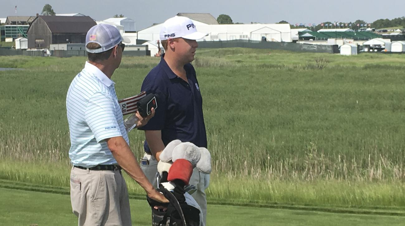 Davis Love III, left, consults with his son, Davis Love IV, on the first fairway at Erin Hills on Sunday, June 11, 2017, during a practice round for the U.S. Open golf tournament in Erin, Wis. The elder Love, who has played 23 U.S. Opens, is caddying for