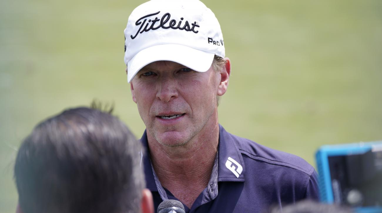 Steve Stricker answers questions after a practice round for the U.S. Open golf tournament Monday, June 12, 2017, at Erin Hills in Erin, Wis. (AP Photo/Morry Gash)